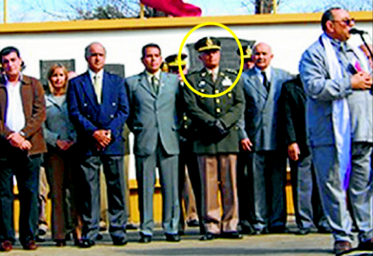 Colonel Roberto Angel Galeano, head encircled. Credit - Cedoc